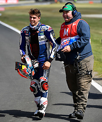October 26, 2018 - Melbourne, Victoria, Australia - Italian rider Fabio Di Gianntonio (#21) of Del Conca Gresini Moto3 is assisted by a marshal after he came off his bike during day 2 of the 2018 Australian MotoGP held at Phillip Island, Australia. (Credit Image: © Theo Karanikos/ZUMA Wire)