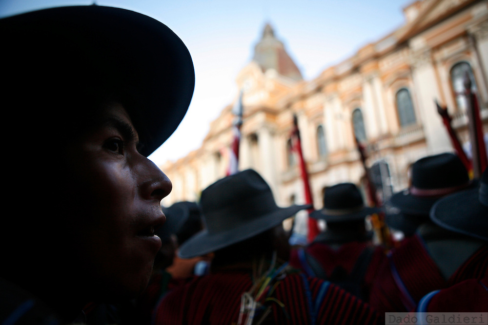 Supporters of Bolivia's President Evo Morales  gather outside Congress, behind, in La Paz, Monday, Oct. 20, 2008. Morales led more than a 100,000 supporters on a march into the Bolivian capital to demand that Congress call a nationwide vote on a new constitution..(AP Photo/Dado Galdieri)