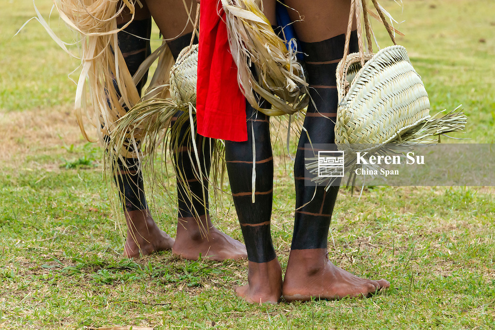 Yapese men in traditional clothing carrying hand bag at Yap Day Festival, Yap Island, Federated States of Micronesia