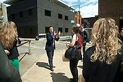 JULIA ROYCE TAKING THE ART TOUR OUTSIDE THE NOBLE/WEBSTER AND WHITEREAD STUDIOS, , Design Your Own Timberland breakfast and Autumn/ Winter 2011 preview. Timberland. 1 Fournier St. London. Followed by an art tour by Julia Royce. 8 June 2011. <br /> <br />  , -DO NOT ARCHIVE-&copy; Copyright Photograph by Dafydd Jones. 248 Clapham Rd. London SW9 0PZ. Tel 0207 820 0771. www.dafjones.com.