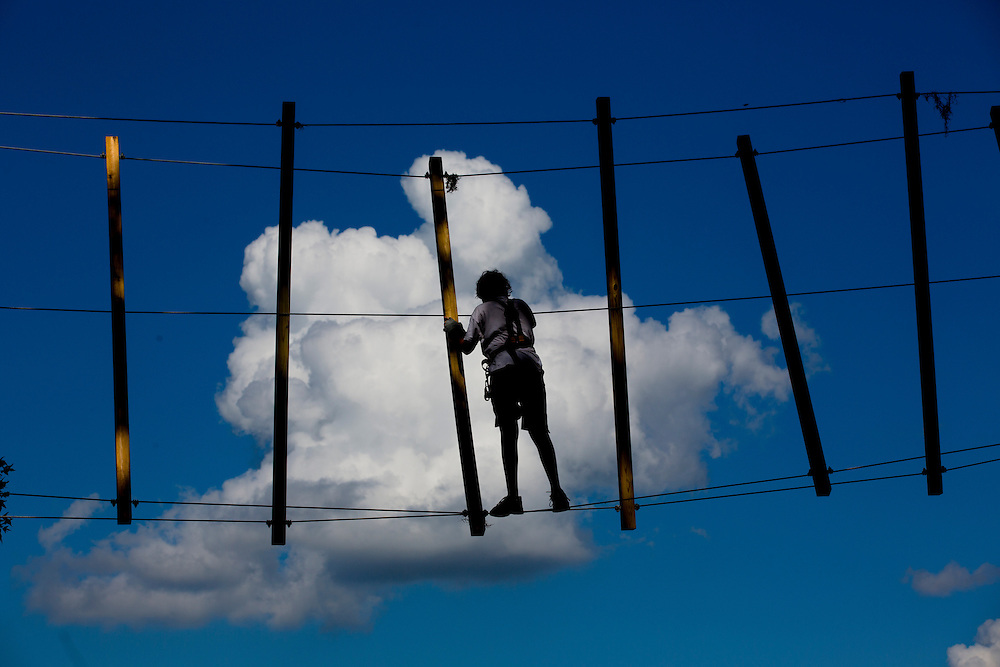 A young guest climbs through the clouds on a element at the TreeHoppers Aerial Adventure Park on September 20, 2015 in Dade City. VISIT FLORIDA/Scott Audette