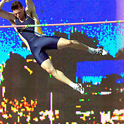 University of California decathlete Bevan Hart clears the bar in the pole vault against the backdrop of the giant scoreboard at the United States  Olympic Track & Field Trials in July of 2000 in Sacramento, Ca.  The pole vault was the 8th of 10 events contested by these elite athletes who were vying for a spot on the United States Olympic team.  Hart did not finish in the top three overall, and failed in his attempt to make the team.