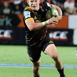 Damian McKenzie makes a break during the Investec Super  Rugby match between the Chiefs and Blues at FMG Waikato Stadium in Hamilton, New Zealand on Friday 3 March 2017. Photo: Dion Mellow / lintottphoto.co.nz
