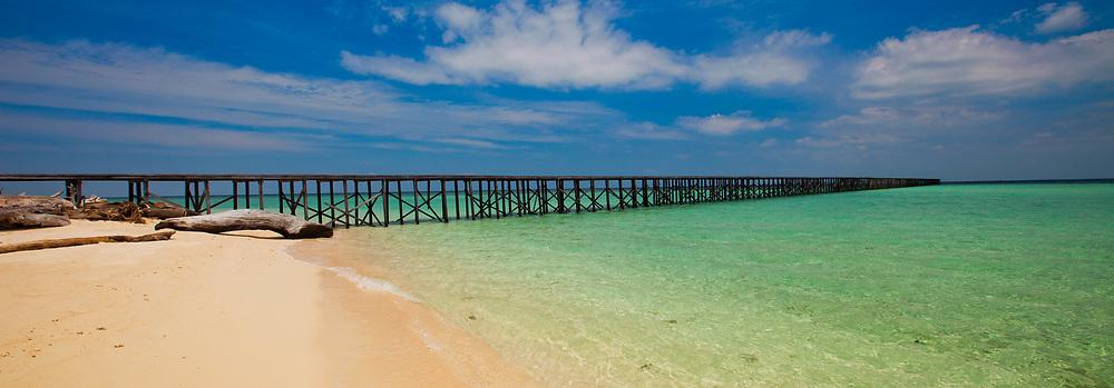 Long Wooden Pier into Ocean at Derawan Sangalaki Island Indonesia Borneo, panorama