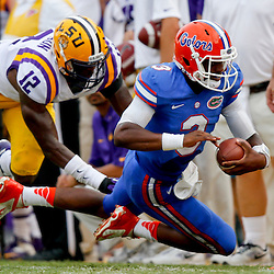 Oct 12, 2013; Baton Rouge, LA, USA; Florida Gators quarterback Tyler Murphy (3) is hit out of bounds by LSU Tigers safety Corey Thompson (12) during the second half of a game at Tiger Stadium. LSU defeated Florida 17-6. Mandatory Credit: Derick E. Hingle-USA TODAY Sports