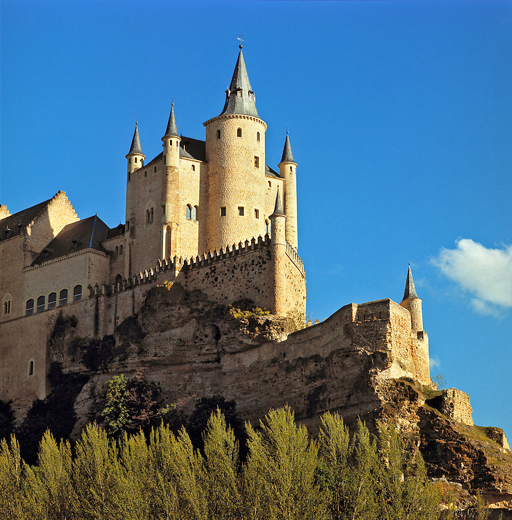 The Alcazar rises imposingly against a summer sky in Segovia, Spain.