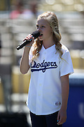 LOS ANGELES, CA - AUGUST 28:  Elena Jane Sogard sings the National Anthem before the Los Angeles Dodgers game against the Chicago Cubs on Wednesday, August 28, 2013 at Dodger Stadium in Los Angeles, California. The Dodgers won the game in a 4-0 shutout. (Photo by Paul Spinelli/MLB Photos via Getty Images) *** Local Caption *** Elena Jane Sogard