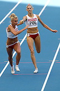 (L) Justyna Swiety and (R) Iga Baumgart both from Poland compete in women's relay 4x400 meters qualification during the 14th IAAF World Athletics Championships at the Luzhniki stadium in Moscow on August 16, 2013.<br /> <br /> Russian Federation, Moscow, August 16, 2013<br /> <br /> Picture also available in RAW (NEF) or TIFF format on special request.<br /> <br /> For editorial use only. Any commercial or promotional use requires permission.<br /> <br /> Mandatory credit:<br /> Photo by © Adam Nurkiewicz / Mediasport