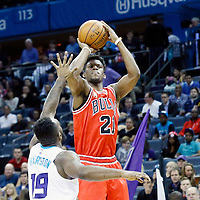 03 November 2015: Chicago Bulls guard Jimmy Butler (21) takes a jump shot over Charlotte Hornets guard P.J. Hairston (19) during the Charlotte Hornets  130-105 victory over the Chicago Bulls, at the Time Warner Cable Arena, in Charlotte, North Carolina, USA.