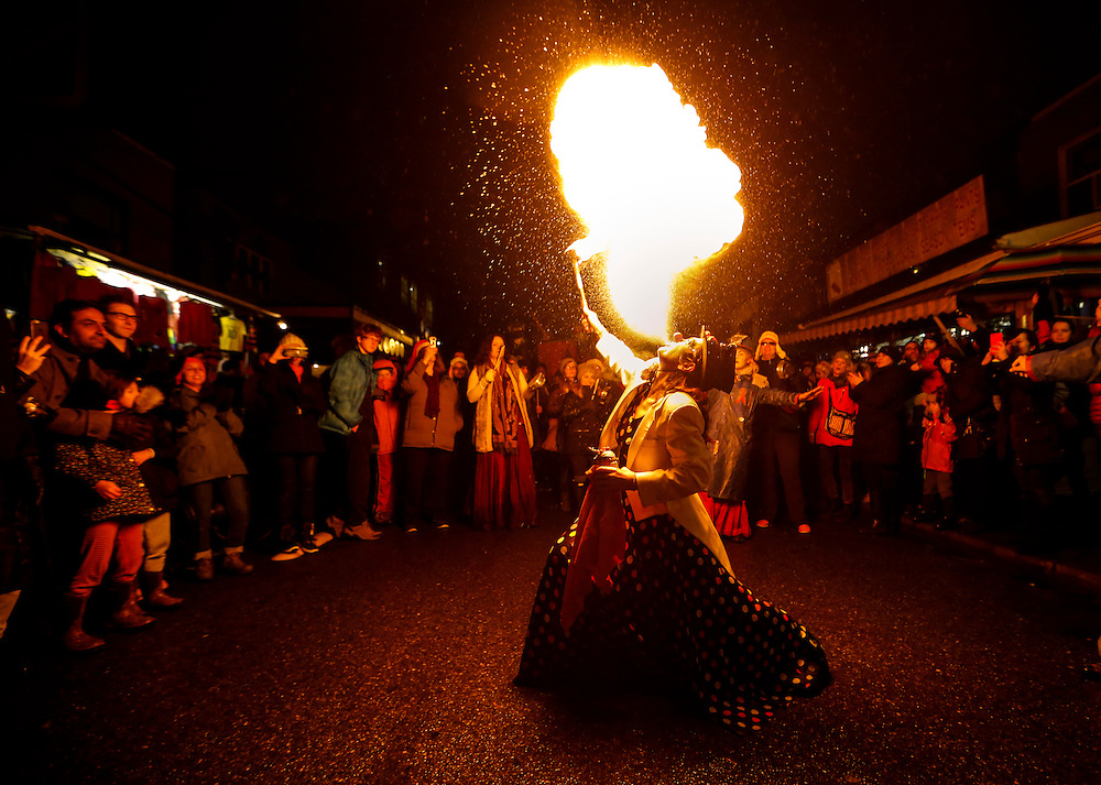 A performer blows fire from her mouth in the 26th Annual Kensington Market Winter Solstice Parade in Toronto, December 21, 2015.    REUTERS/Mark Blinch