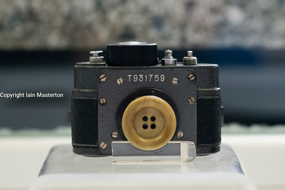 Button spy camera on display at offices of East German secret Police now STASI Museum in Berlin Germany