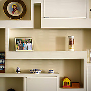 June 1, 2016 - New York, NY : The Missionary Sisters of the Immaculate Heart of Mary (I.C.M.)  are selling their 25-bedroom, two-story, combined two-townhome property located at 236 East 15th Street. Here, a variety of items collected by the sisters, including a photograph of the general leadership for the congregation, left, and a candle bearing an image of Pope Francis, share space on a shelf in the home's living room. CREDIT: Karsten Moran for The New York Times
