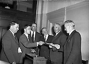 15/05/1959<br /> 05/15/1959<br /> 15 May 1959<br /> General Sean Mac Eoin nominated for the Presidency. General Mac Eoin T.D. handed in his nomination papers as Candidate for the Presidential Election to the Returning officer Mr. Michael Lawless at the Custom House Dublin. Picture shows General Mac Eoin (2nd from right) and his election agent, Mr. J. Finbar O'Reilly (second from left) handing in his papers to Michael Lawless.