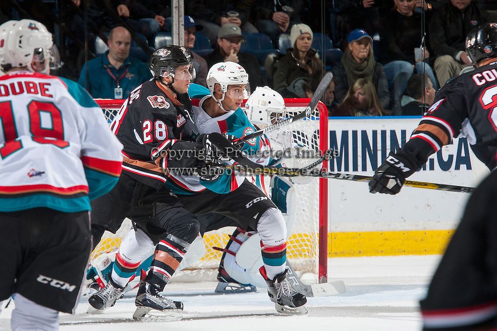 KELOWNA, CANADA - FEBRUARY 1: Devante Stephens #21 of the Kelowna Rockets checks Tyler Mrkonjic #28 of the Calgary Hitmen on February 1, 2017 at Prospera Place in Kelowna, British Columbia, Canada.  (Photo by Marissa Baecker/Shoot the Breeze)  *** Local Caption ***