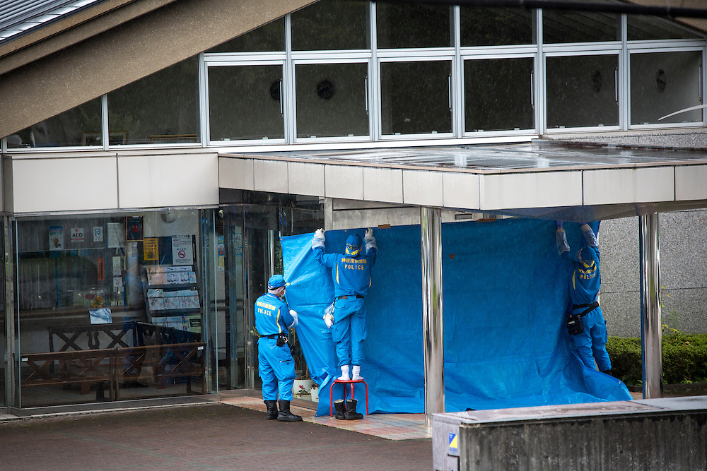 SAGAMIHARA, JAPAN - JULY 26 :  Police investigators try to cover the main entrance of Tsukui Yamayuri-en building as they continue to investigate on knife attack in a handicap center at Sagamihara on Wednesday, July 26, 2016 in Kanagawa prefecture, Japan. Police arrested 26 year old Satoshi Uematsu after breaking inside the building facility for handicapped and killing 19 people and injuring 20 in the city of Sagamihara, west of Tokyo. (Photo: Richard Atrero de Guzman/NURPhoto)