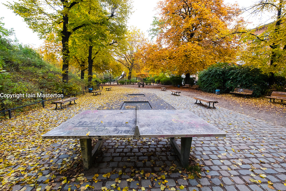 Empty playground in park at Wasserturm or Watertower in Prenzlauer Berg during autumn in Berlin Germany