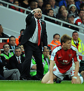 Rafael Benitez gives his Liverpool team instructions from the sideline. Arsenal v Liverpool (2-1), The Carling Cup 4th Round, Emirates Stadium, London, 28th Oct 2009.