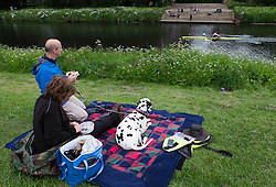 © Licensed to London News Pictures.13/06/15<br /> Durham, England<br /> <br /> A couple and their dog sit and watch the racing during the 182nd Durham Regatta rowing event held on the River Wear. The origins of the regatta date back  to commemorations marking victory at the Battle of Waterloo in 1815. This is the second oldest event of this type in the country and attracts over 2000 competitors from across the country.<br /> <br /> Photo credit : Ian Forsyth/LNP
