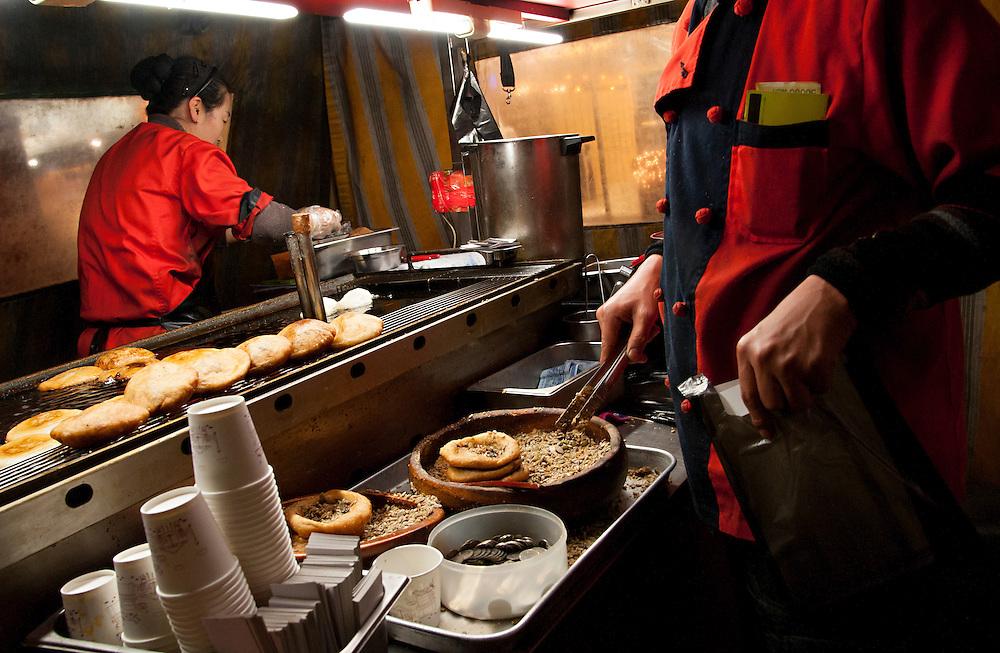 Preparing hotteok, a popular sweet pancake, at a stall in Seomyeon. Busan, South Korea.