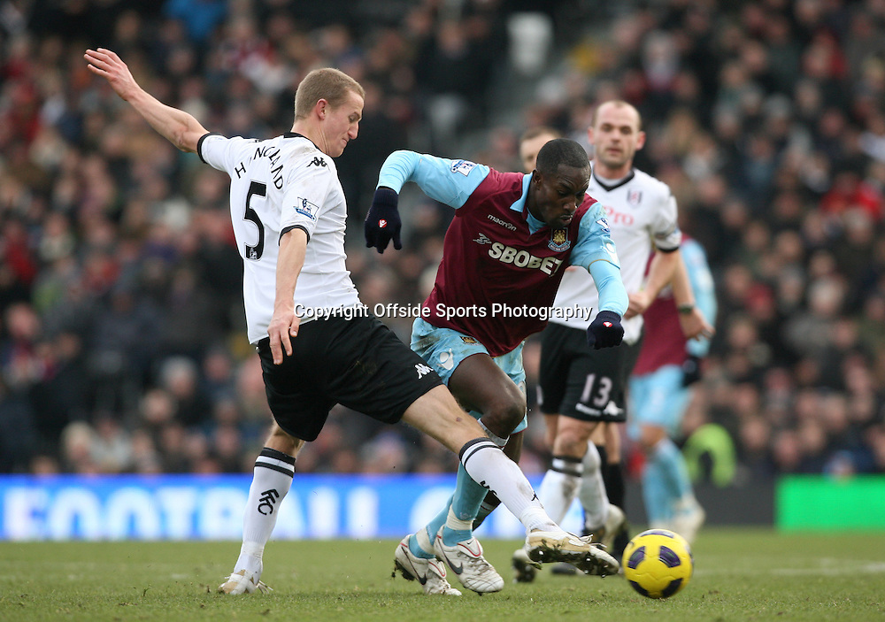 26/12/2010 - Barclays Premier League - Fulham vs. West Ham United - Brede Hangeland of Fulham battles with Carlton Cole of West Ham - Photo: Simon Stacpoole / Offside.