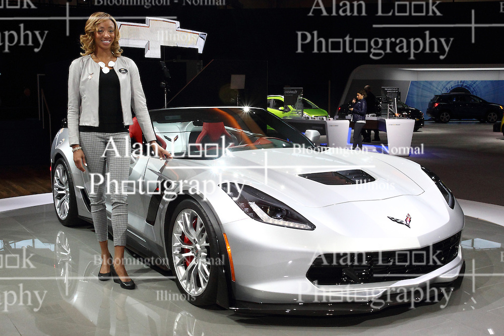 12 February 2015: Displayed by female model - 2015 CHEVROLET CORVETTE Z06: Chevrolet's 2015 Corvette Z06 enters supercar territory with race-proven design, advanced technologies and world-class performance. The Corvette Z06 is the most capable, world-class Corvette model, ever. It's the first Z06 since 1963 offered in coupe and convertible models. This is the first Corvette Z06 to offer supercharged engine, and thanks to a stronger aluminum frame, a removable roof panel. The heart of the 2015 Corvette Z06 is the all-new LT4 6.2L supercharged V-8 engine, expected to deliver an estimated 625 horsepower and massive 635 lb-ft of torque to the rear-wheel drive. Standard seven-speed manual transmission includes the Active Rev Match feature, or there is an all-new eight-speed paddle-shift automatic transmission designed to enhance both performance and MPGs.  Strap-in tightly, as the Z06 blasts from 0-to-60 mph in 2.95 seconds with the eight-speed automatic and 3.2 secs. with the seven-speed shifter. To balance performance and efficiency, the LT4 leverages the same trio of advanced technologies introduced on the Corvette Stingray: Direct injection, Active Fuel Management, or cylinder deactivation, and continuously variable valve timing. These technologies – combined with the fuel-efficient multi-speed transmissions, aerodynamic design and lightweight construction – help make the new Z06 surprisingly fuel efficient. The 2015 Corvette Z06 with the available Z07 package adds larger winglets to the carbon front splitter, along with an adjustable, see-through center section on the rear spoiler for track use; with this package, the Corvette Z06 delivers the most amount of aerodynamic downforce of any production car that GM has tested.<br /> <br /> First staged in 1901, the Chicago Auto Show is the largest auto show in North America and has been held more times than any other auto exposition on the continent. The 2015 show marks the 107th edition of the Chicago Auto Show. It has been