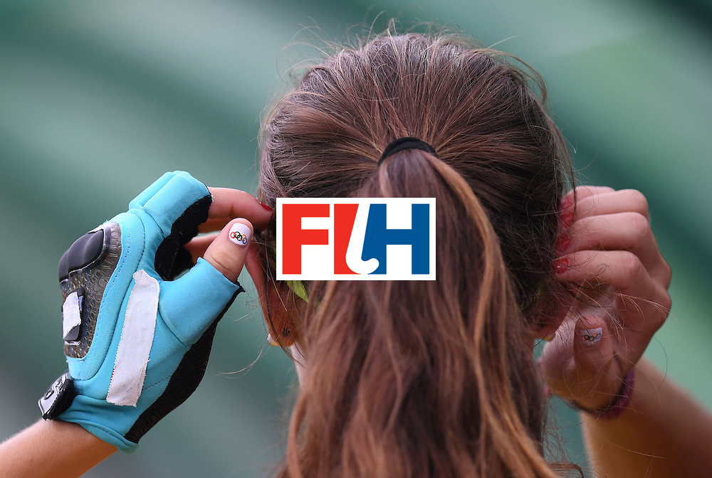 Spain's Carola Salvatella adjusts her hair during the women's field hockey Spain vs New Zealand match of the Rio 2016 Olympics Games at the Olympic Hockey Centre in Rio de Janeiro on August, 10 2016. / AFP / MANAN VATSYAYANA        (Photo credit should read MANAN VATSYAYANA/AFP/Getty Images)