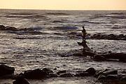 Throw net fisherman, sunrise, Wailua River State Park, Kauai, Hawaii