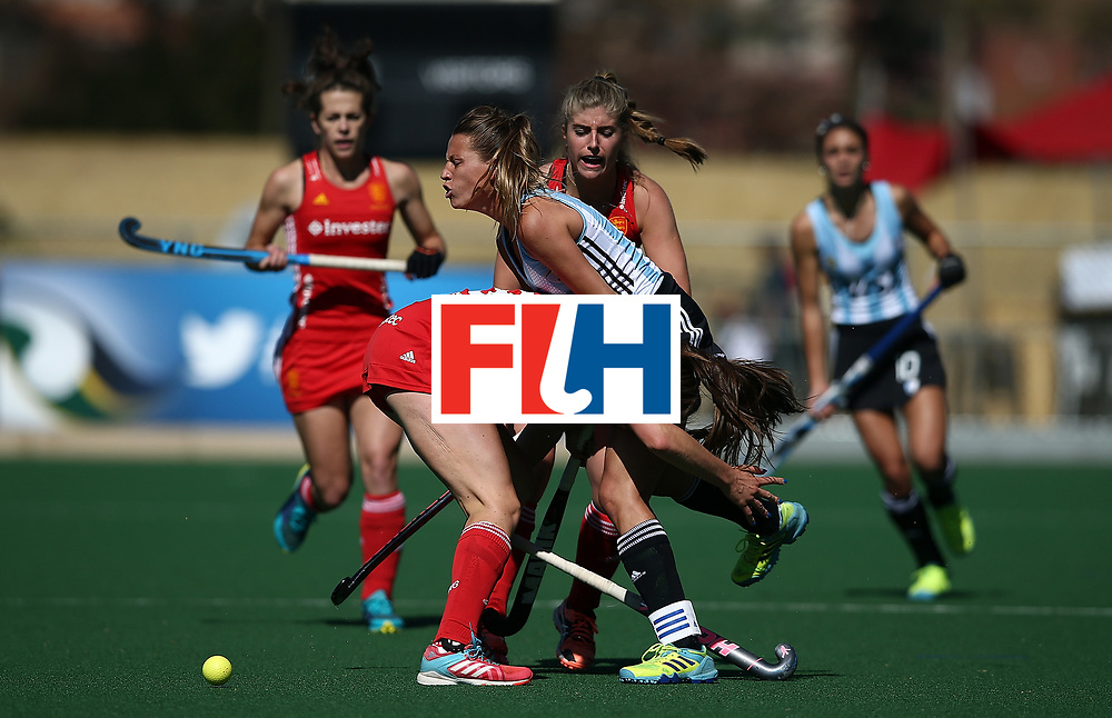 JOHANNESBURG, SOUTH AFRICA - JULY 23:  Delfina Merino of Argentina crashes into Giselle Ansley of England during day 9 of the FIH Hockey World League Women's Semi Finals 3rd/ 4t place match between England and Argentina at Wits University on July 23, 2017 in Johannesburg, South Africa.  (Photo by Jan Kruger/Getty Images for FIH)