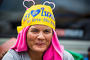 24 NOVEMBER 2013 - BANGKOK, THAILAND:     A Royalist anti-government protestor wearing a headband that says Long Live the King on Rathchdamnoen Ave in Bangkok. More than 400,000 people packed onto Ratchdamnoen Ave in Bangkok Sunday, continuing an anti-government protest that started weeks ago over a blanket amnesty bill passed by the Thai Parliament. The amnesty bill was defeated in the Thai Senate and the protest morphed into a general protest against the government. The protestors are allied with the Thai Democrat party, the opposition party in parliament. Tens of thousands of pro-government Red Shirts have come to Bangkok to defend the government and are rallying in a different part of the city. Police have warned of clashes between the two groups but as of Sunday evening no problems had been reported. The protestors allege that the amnesty would allow fugitive former Prime Minister Thaksin Shinawatra to return to Thailand.        PHOTO BY JACK KURTZ