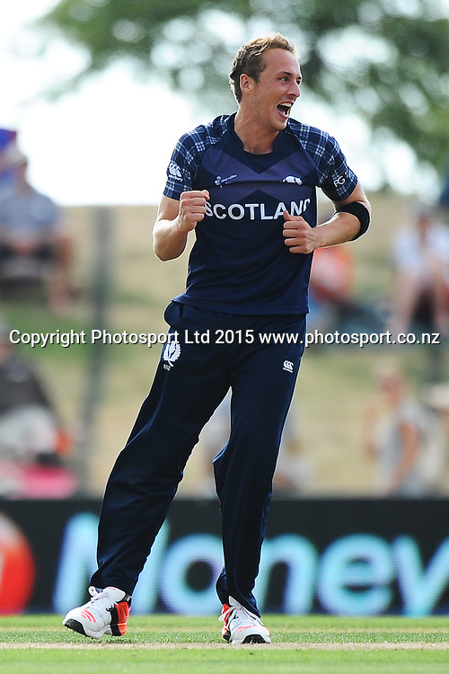 Scotland player Josh Davey celebrates the wicket of Tamin Iqbal during the 2015 ICC Cricket World Cup match between Bangladesh v Scotland. Saxton Oval, Nelson, New Zealand. Thursday 5 March 2015. Copyright Photo: Chris Symes / www.photosport.co.nz