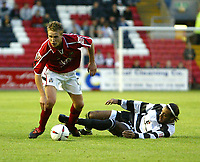 Photo. Andrew Unwin.Digitalsport<br /> Darlington v Barnsley, Carling Cup First Round, Williamson Motors Stadium, Darlington 24/08/2004.<br /> Darlington's Matt Clarke (R) looks to tackle Barnsley's Chris Hughes (L).