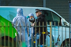 © Licensed to London News Pictures. 05/12/2019. London , UK. Forensic investigators gather evidence at the scene of a fatal stabbing in Clarence Mews, Hackney. Police were called at 14:01 GMT and attended alongside London Ambulance Service and London's Air Ambulance where they found a man seriously injured. Despite their best efforts the man - believed to be aged in his 20s - was pronounced dead at the scene at 14:33hrs. Photo credit: Peter Manning/LNP