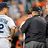 09 June 2009:  Seattle Mariners manager Don Wakamatsu (22) and Baltimore Orioles manager Dave Trembley listen as home plate umpire Gary Cederstrom (R) rules that Orioles third baseman Melvin Mora is out after an apparent home run because of fan interference in the 1st inning at Camden Yards in Baltimore, MD.  The Orioles defeated the Mariners 3-1.  ****For Editorial Use Only****