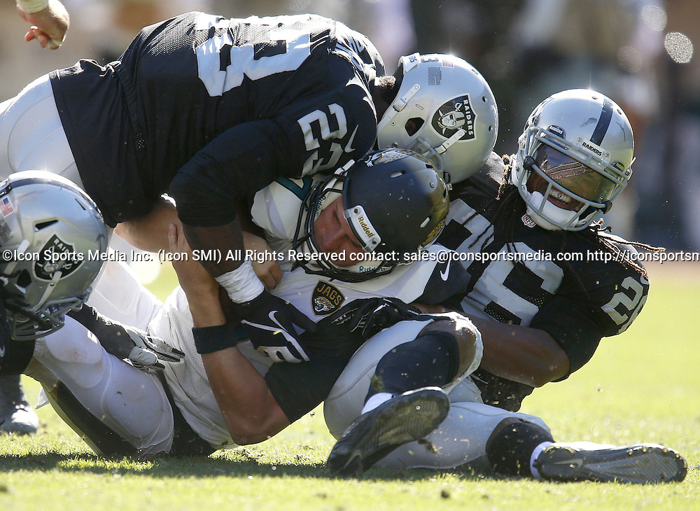 Sept. 15, 2013 - Oakland, CA, USA - Jacksonville Jaguars starting quarterback Chad Henne (7) is sacked by Oakland Raiders' Usama Young (26) and Oakland Raiders' Tracy Porter (23) in the fourth quarter at the O.co Coliseum in Oakland, California, on Sunday, September 15, 2013