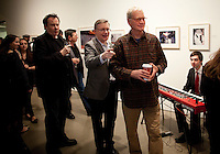 """David Letterman at his staff's holiday party and photo gallery exhibition by his staff writer Steve Young (left) entitled """"CELEBRIGUM"""" held at Ameringer McEnery Yohe Gallery  in New York. ..Photo by Robert Caplin."""