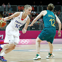 30 July 2012: Florence Lepron of France drives past Belinda Snell of Australia during the 74-70 Team France overtime victory over Team Australia, during the women's basketball preliminary, at the Basketball Arena, in London, Great Britain.