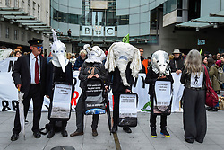 © Licensed to London News Pictures. 11/10/2019. LONDON, UK.  Members of Extinction Rebellion dressed as endangered or extinct animals protest outside the headquarters of BBC at Portland Place on day 5 of their demonstrations.  Climate activists are demanding that the government takes immediate action against the negative effects of climate change.  Photo credit: Stephen Chung/LNP