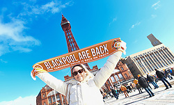 Fans celebrating the Oyston's departure from the club with a Blackpool are back scarf
