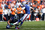 Buffalo Bills punter Colton Schmidt (6) holds while Buffalo Bills kicker Stephen Hauschka (4) kicks a 49 yard field goal that ties the second quarter score at 10-10 during the 2017 NFL week 3 regular season football game against the against the Denver Broncos, Sunday, Sept. 24, 2017 in Orchard Park, N.Y. The Bills won the game 26-16. (©Paul Anthony Spinelli)