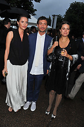 Left to right, SASHA VOLKOVA, DAN MACMILLAN and the HON.REBECCA MACMILLAN at the annual Serpentine Gallery Summer Party sponsored by Burberry held at the Serpentine Gallery, Kensington Gardens, London on 28th June 2011.