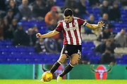 Brentford FC defender John Egan (14) looks to release the ball during the EFL Sky Bet Championship match between Birmingham City and Brentford at St Andrews, Birmingham, England on 1 November 2017. Photo by Dennis Goodwin.