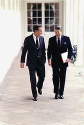 May 3, 1988 - Washington, District of Columbia, United States of America - Washington, D.C. - May 3, 1988 -- United States President Ronald Reagan and Vice President George H.W. Bush walk on the Colonnade at the White House in Washington, DC on May 3, 1988..Credit: White House via CNP (Credit Image: © White House/CNP/ZUMAPRESS.com)