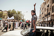 Misrata residents march to an exhibition of captured tanks and various weapons from Gadhafi's army in downtown Misrata. 10 June 2011.
