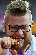 Great Britain, London - 2017 August 12: Pawel Fajdek (Agros Zamosc) of Poland bites his gold medal in men's hammer throw while awarding ceremony during IAAF World Championships London 2017 Day 9 at London Stadium on August 12, 2017 in London, Great Britain.<br /> <br /> Mandatory credit:<br /> Photo by © Adam Nurkiewicz<br /> <br /> Adam Nurkiewicz declares that he has no rights to the image of people at the photographs of his authorship.<br /> <br /> Picture also available in RAW (NEF) or TIFF format on special request.<br /> <br /> Any editorial, commercial or promotional use requires written permission from the author of image.
