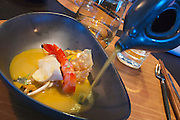 Sylt, Germany. List. Spa Resort A-Rosa Sylt. Spices Restaurant. SINGAPORE LAKSA, Carabinero und Miesmuscheln, Tagesfisch, Chinese Fishcake, Limquatgel, Sprossen, Yuba und Eigelb, Kokos-Chilisuppe.