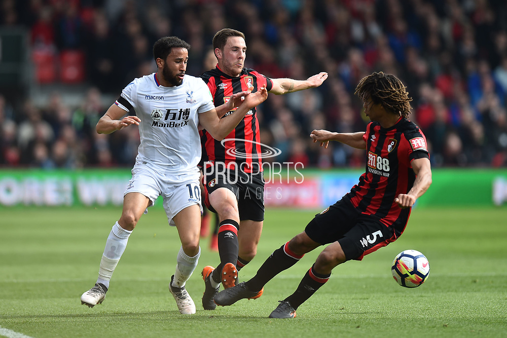 Andros Townsend (10) of Crystal Palace is challenged by Dan Gosling (4) of AFC Bournemouth and Nathan Ake (5) of AFC Bournemouth during the Premier League match between Bournemouth and Crystal Palace at the Vitality Stadium, Bournemouth, England on 7 April 2018. Picture by Graham Hunt.