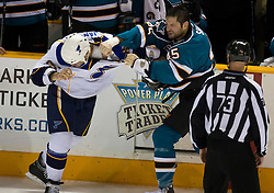 January 6, 2010; San Jose, CA, USA; San Jose Sharks left wing Jody Shelley (45) fights with St. Louis Blues right wing Cam Janssen (55) during the second period at HP Pavilion. San Jose defeated St. Louis 2-1 in overtime. Mandatory Credit: Jason O. Watson / US PRESSWIRE