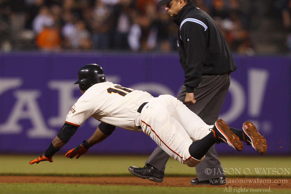 July 7, 2011; San Francisco, CA, USA;  San Francisco Giants third baseman Miguel Tejada (10) dives into second base for a double against the San Diego Padres during the sixth inning at AT&T Park.