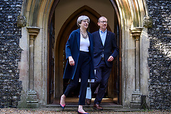 © Licensed to London News Pictures. 11/06/2017. Maidenhead, UK. British prime minister THERESA MAY attends church her constituency in Maidenhead, Berkshire, with her husband PHILIP, a few days after disappointing results in a general election. The Labour Party made significant gains in an election that was expected to be a comfortable victory the the Conservative Party . Photo credit: Ben Cawthra/LNP