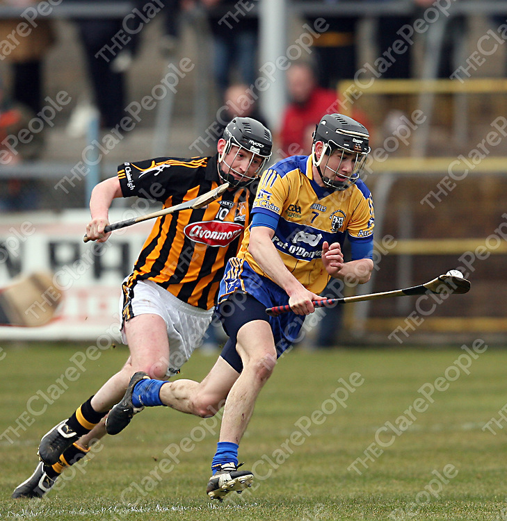 Clare's Patrick Donnellan swings in around Kilkenny's Martin Comerford during their National Hurling League clash in Cusack Park on Sunday.<br /> Photograph by Yvonne Vaughan